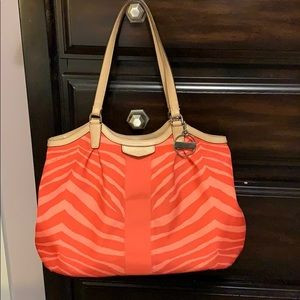 Coral colored Coach bag